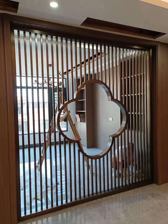 不锈钢屏风隔断轻奢现代新中式钛金金属镂空花格假山玄关工程定制