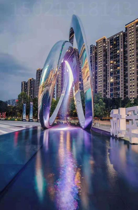 上海主题街区 旋转圆环雕塑 水景灯光雕塑作品图